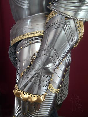 Closeup of a Gothic gauntlet showing piercing and file work
